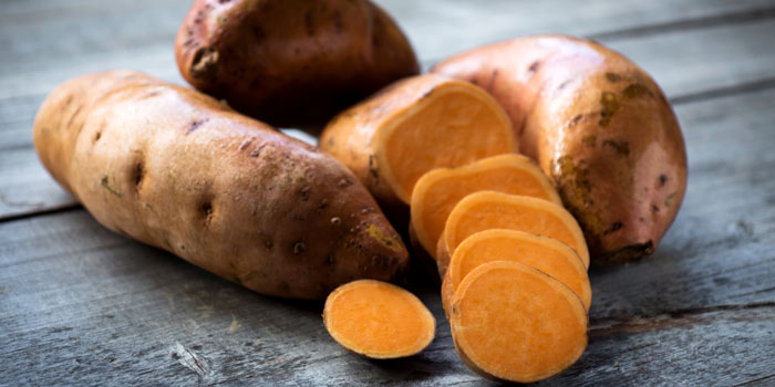 sweet-potatoes-on-wood-surface